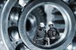 giant machinery and mechanics standing inside gianr bearings, steel works