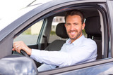 Fototapety Young attractive man driving his car