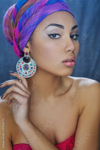 Plagát Young African beauty in ethnic headpiece