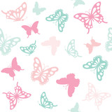 Seamless pattern background with butterflies in pastel colors.