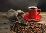 Fototapety Coffee cup and coffee beans on wooden table