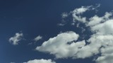 pure fluffy white clouds in blue sky time lapse