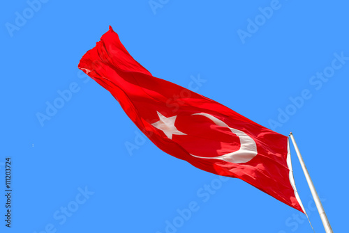 Waving Turkish flag on blue background Poster