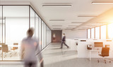 Blurry business man walking inwhite  office interior