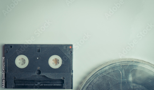 Video tape and movie film on Blue vintage blank page | Buy