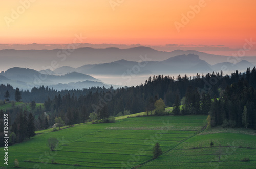 mata magnetyczna Moments before sunrise in misty Carpathian mountains, spring, Poland