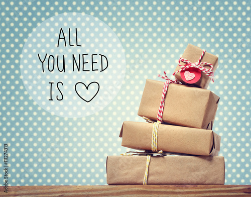 Poster All You Need Is Love message with gift boxes
