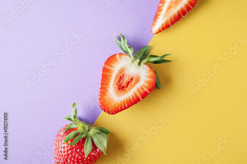 Strawberry close-up on yellow violet background, fruits summer - 111276101