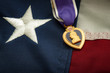 The Purple Heart is a United States military decoration awarded in the name of the President to those wounded or killed while serving and the american flag