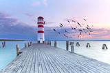 langer Steg zum Leuchtturm, Sonnenuntergang am See