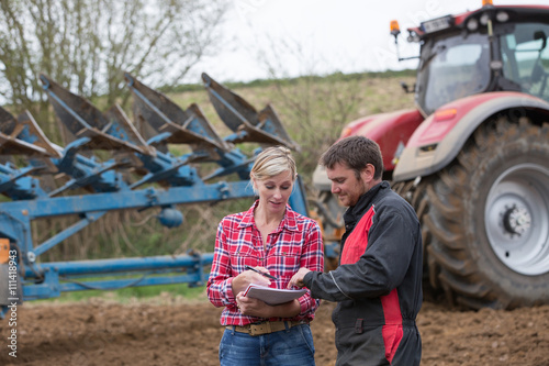 Poster saleswoman try to sell new tractor to farmer
