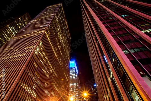 Fototapeta skyscrapers windows at the night in New York City