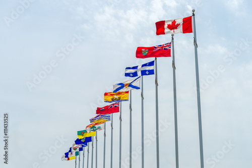 Poster Canada Picture of the canadian Flag along with the flags of the 10 Canadian Provinces and the 3 Canadian Territories, in Ottawa, Canada
