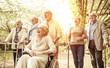 Group of old people walking outdoor
