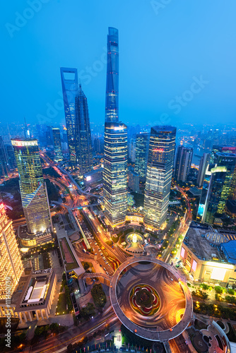Fotobehang Shanghai Night view of Lujiazui. Since the early 1990s, Lujiazui has been developed specifically as a new financial district of Shanghai.