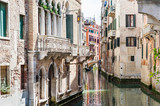 Scenic canal with bridge and ancient buildings in Venice, Italy