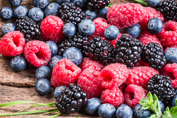 Fresh berries, blueberry, raspberry, blackberry closeup background.