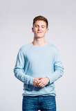 Boy in jeans and sweater, young man, studio shot