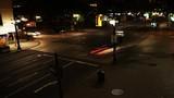 4K UltraHD Cars and people at an intersection at night