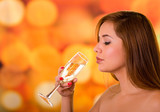 Woman ready to drink champagne in a cup, colored background