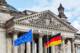 German Reichstag in Berlin, Germany, with national flags - 111595595
