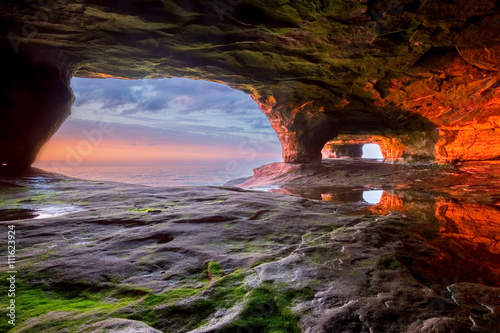 Sea Cave on Lake Superior at Sunset Poster