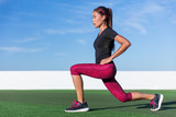 Fitness woman doing lunges exercises for glute and leg muscle workout training core muscles, balance, cardio and stability. Active crossfit girl doing front forward one leg step lunge exercise.