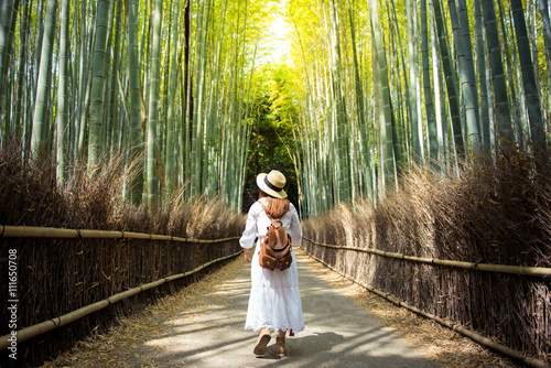 Plexiglas Bamboe Touist is walking inside bamboo forest Arashiyama, Kyoto, Japan.