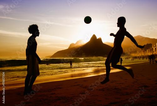 Two soccer players at beach at Rio de Janeiro