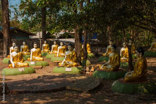 Statues of sitting Buddhas. Bago. Myanma. Burma. Poster