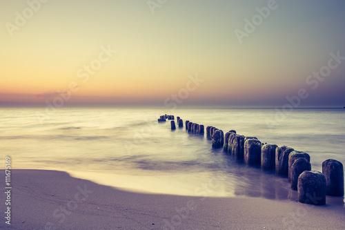 Zdjęcia na płótnie, fototapety na wymiar, obrazy na ścianę : Piękny kolorowy wschód słońca nad Bałtykiem
