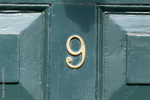 Poster House Number 9 sign on wooden door