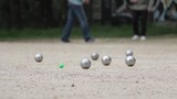 Simultaneous Games of Petanque. Pétanque is a form of boules where the goal is to throw steel balls as close as possible to a small wooden ball called a cochonnet .