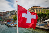 Waving Swiss flag on Lugano Lake boat