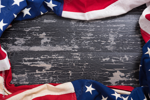 Old American Flag on wooden plank background Poster