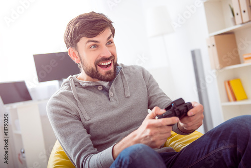 Poster Man playing videogames and holding joystick