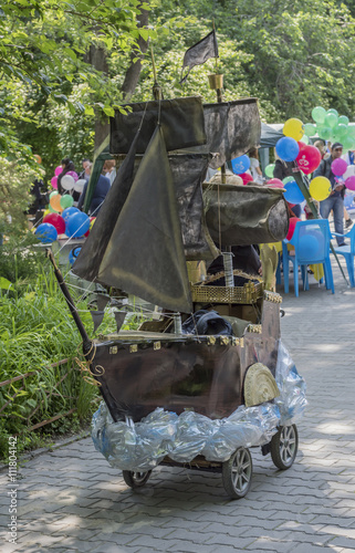 Poster  Pram in the form of a sailing boat in the park named after V. C