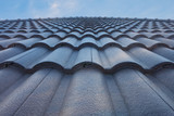 tile roof with blue sky - 111804783