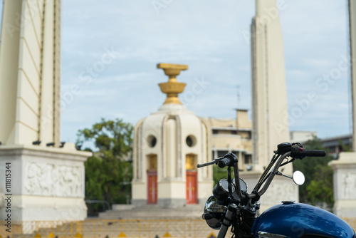 Poster Classic Motocycle touring in front of Giant Brahmin swing is lan