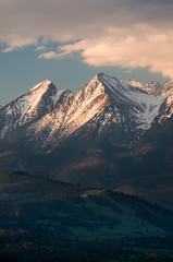 Cloudy Tatra mountains in the morning, covered with snow © tomeyk