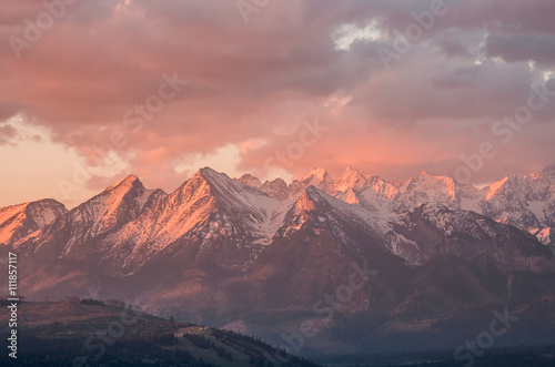 Cloudy Tatra mountains in the beautiful morning, covered with snow