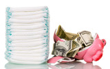 Stack  diapers, broken piggy bank and money isolated on white.