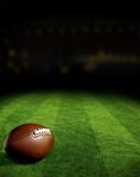 Fototapety American football on green field stadium at night