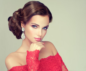 Beautiful model with elegant hairstyle . Beautiful woman with fashion wedding hairstyle with trend  makeup  .