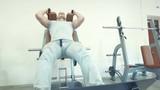 Man in hack machine doing leg press