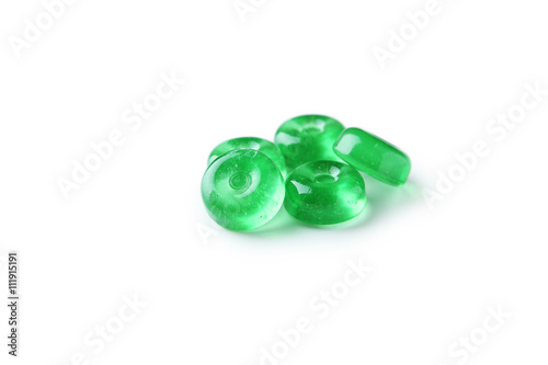 Póster Green candies isolated on white