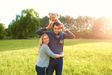 Happy family having fun outdoors and smiling. Mom,dad and daught
