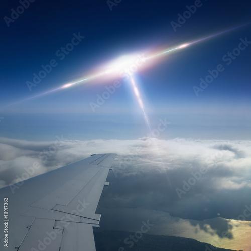 Foto op Canvas Ufo flies near airplane