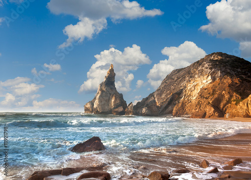 Summer ocean shore, fantastic rock, stones and water waves