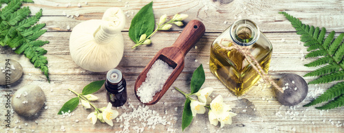 Fototapeta Spa setting with jasmine essential oil and flowers. Wellness con
